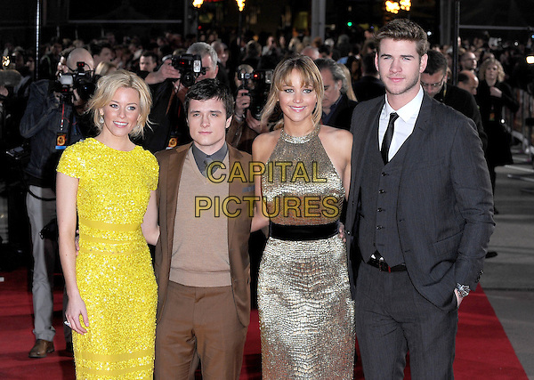 Elizabeth Banks, Josh Hutcherson, Jennifer Lawrence & Liam Hemsworth.European Premiere of 'The Hunger Games' at Cineworld at the O2 Arena, London, England..March 14th 2012.half length brown suit jumper sweater gold sleeveless dress black belt grey gray suit waistcoat yellow.CAP/BEL.©Tom Belcher/Capital Pictures.