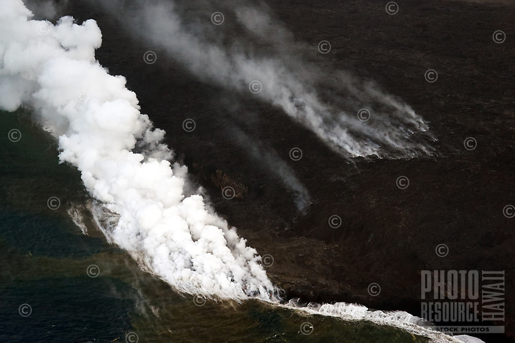 An aerial view of the smoke billowing from the 61G lava flow ocean entry, Kamokuna, the Big Island of Hawai'i.