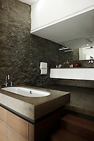 """The bathroom walls are clad in an unusual Portuguese stone called """"Armorican Blue"""""""