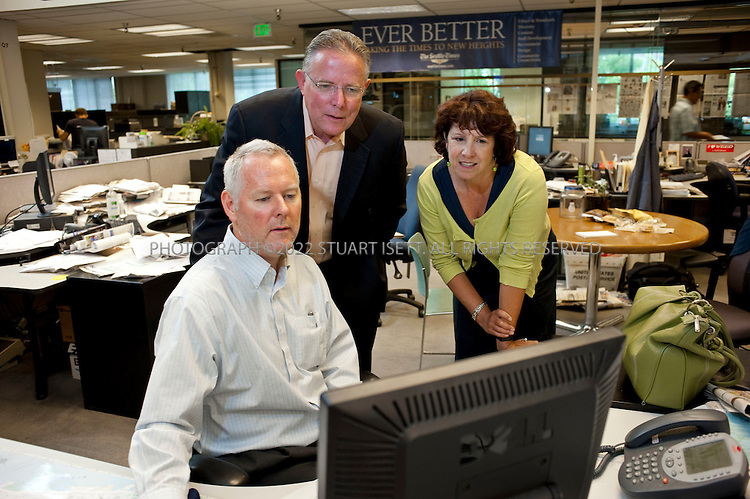 "8/5/2009--Seattle, WA, USA..Dave Boardman (center), the executive editor of the Seattle Times talks with Suki Dardarian (right), managing editor and Mark Higgins (left), metro editor...The Seattle Times is the largest daily newspaper in the state of Washington and from 1983 to 2009, the Times and Seattle's other major paper, the Hearst-owned Seattle Post-Intelligencer, were run under a ""Joint Operating Agreement"". This arrangement ended on March 17, 2009, when the Seattle Post-Intelligencer ceased publication, leaving The Seattle Times as Seattle's only major daily newspaper...©2009 Stuart Isett. All rights reserved."