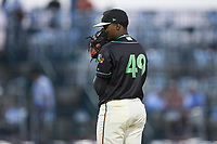Ocelotes de Greensboro relief pitcher Yerry De Los Santos (49) looks to his catcher for the sign against the Hickory Crawdads at First National Bank Field on June 11, 2019 in Greensboro, North Carolina. The Crawdads defeated the Ocelotes 2-1. (Brian Westerholt/Four Seam Images)