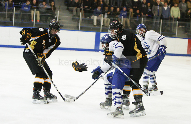 UK and Missouri players collide in the open ice during the UK men's hockey game versus Missouri at Lexington Ice Center in Lexington, Ky., on Saturday, November, 9, 2013. Photo by Jonathan Krueger | Staff