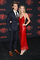 Joe Keery &amp; Maika Monroe at the premiere for Netflix's &quot;Stranger Things 2&quot; at the Westwood Village Theatre. Los Angeles, USA 26 October  2017<br /> Picture: Paul Smith/Featureflash/SilverHub 0208 004 5359 sales@silverhubmedia.com