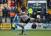 Haydn Hollis of Notts County beats Rowan Liburd (Loanee from Reading) of Wycombe Wanderers to the ball during the Sky Bet League 2 match between Notts County and Wycombe Wanderers at Meadow Lane, Nottingham, England on 28 March 2016. Photo by Andy Rowland.
