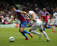 Pictured L-R: Joel Ward of Crystal Palace against Jefferson Montero of Swansea<br />