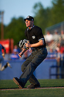 Umpire Louie Krupa watches a ball down the line during a game between the Brooklyn Cyclones and Batavia Muckdogs on July 5, 2016 at Dwyer Stadium in Batavia, New York.  Brooklyn defeated Batavia 5-1.  (Mike Janes/Four Seam Images)