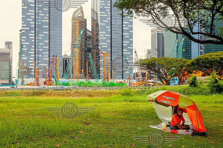 A labourer rests near a construction site.
