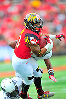 Terrapins DeAndre Lane tries to extend the play after catching the ball. Maryland routed Howard 52-13 during home season opener at Capital One Field in College Park, MD on Saturday, September 3, 2016.  Alan P. Santos/DC Sports Box
