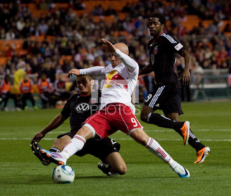 Chris Korb (22) of D.C. United tackles the ball away from Luke Rodgers (9) of the New York Red Bulls during the game at RFK Stadium in Washington, DC.  D.C. United lost to the New York Red Bulls, 4-0.