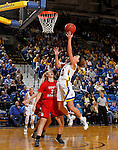 BROOKINGS, SD - JANUARY 17:  Kerri Young #10 from South Dakota State takes the ball to the basket against Nicole Seekamp #35 from the University of South Dakota in the second half of their game Sunday afternoon at Frost Arena in Brookings, S.D. (Photo by Dave Eggen/Inertia)