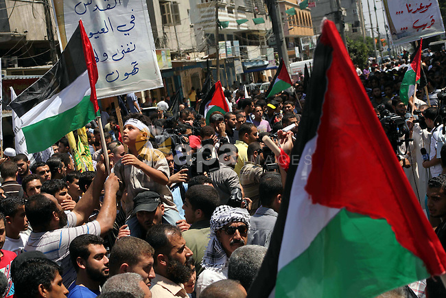 Palestinian demonstrators chant slogans during an annual rally marking Al-Quds Day (Jerusalem Day), on the last Friday of the holy month of Ramadan, in Gaza city, Friday, Aug. 17, 2012. Photo by Ashraf Amra