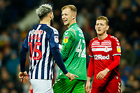 29th December 2019; The Hawthorns, West Bromwich, West Midlands, England; English Championship Football, West Bromwich Albion versus Middlesbrough; Aynsley Pears of Middlesbrough laughs off Charlie Austin of West Bromwich Albion after a confrontation - Strictly Editorial Use Only. No use with unauthorized audio, video, data, fixture lists, club/league logos or 'live' services. Online in-match use limited to 120 images, no video emulation. No use in betting, games or single club/league/player publications