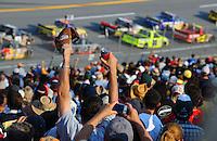 Oct 4, 2008; Talladega, AL, USA; NASCAR Craftsman Truck Series fans cheer during the Mountain Dew 250 at the Talladega Superspeedway. Mandatory Credit: Mark J. Rebilas-