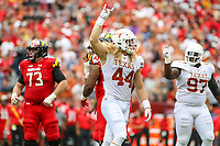 Landover, MD - September 1, 2018: Texas Longhorns defensive lineman Breckyn Hager (44) celebrates after making a tackle during the game between Texas and Maryland at  FedEx Field in Landover, MD.  (Photo by Elliott Brown/Media Images International)