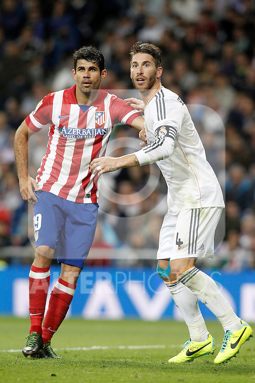 Real Madrid's Sergio Ramos (r) and Atletico de Madrid's Diego Costa  during La Liga match.September 28,2013. (ALTERPHOTOS/Acero)