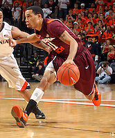 Virginia Tech guard Erick Green (11) handles the ball during the game Tuesday in Charlottesville, VA. Virginia defeated Virginia Tech73-55.