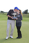 Final Day of the 100th Irish PGA championship at Seapoint Golf Club, Co Louth..David Mortimer with his winners trophy and finance Samantha.Picture Fran Caffrey/www.golffile.ie.