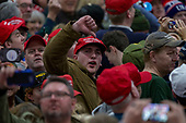 A supporters gives the media a thumbs down as United States President Donald J. Trump speaks during a Make America Great Again campaign rally at Atlantic Aviation in Moon Township, Pennsylvania on March 10th, 2018. Credit: Alex Edelman / CNP