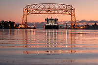 The thousand footer, American Integrity, quietly glided through the thin ice of the Duluth Harbor as it departed this morning.