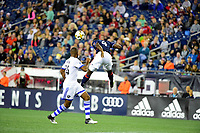 September 9, 2017 - Foxborough, Mass: New England Revolution defender Angoua Brou Benjamin (4) heads the ball  during the MLS game between the Montreal Impact and the New England Revolution held at Gillette Stadium in Foxborough Massachusetts. Revolution defeat Impact 1-0. Eric Canha/CSM