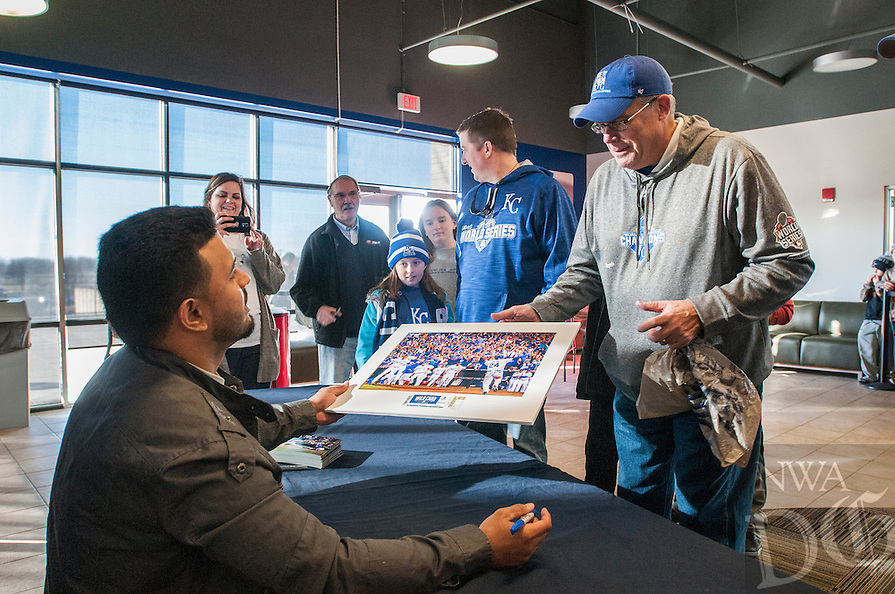 NWA Democrat-Gazette/ANTHONY REYES &bull; @NWATONYR<br /> Christian Colon, infielder for the Kansas City Royals, signs a photo for Jim Pawlus of Joplin, Monday, Jan. 18, 2016 at Arvest Ballpark in Springdale. Colon was the Kansas City Royals infielder that hit the go ahead run in the World Series against the New York Mets. He was on hand for autographs and a few photos as the Kansas City Royals' 2015 World Series Trophy was on display at the ballpark.
