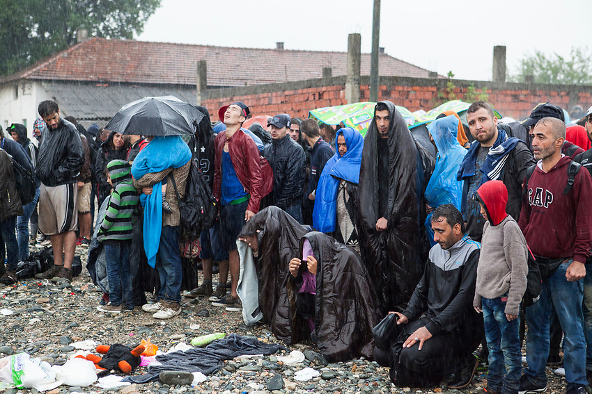 Refugees at the UNHCR Registration centre in Gegeliya , wait to board a train that will take them to the Serbia border with Macedonia. The refugees had to wait in the pouring rain. The boarding was chaotic as it poured down with heavy rain. Refugees at Gevgelija Border Crossing Macedonian Side.
