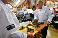 Melbourne, 30 May 2017 - Tom Milligan of the Bocuse d'Or Academy Australia helps Michael Cole of the Georgie Bass Cafe & Cookery in Flinders present his meat platter at the Australian selection trials of the Bocuse d'Or culinary competition held during the Food Service Australia show at the Royal Exhibition Building in Melbourne, Australia. Photo Sydney Low