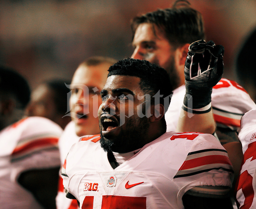 Ohio State Buckeyes running back Ezekiel Elliott (15) sings Carmen Ohio at the end  the Ohio State Buckeyes win against the Indiana Hoosiers at Memorial Stadium in Bloomington Indiana Oct. 3, 2015.(Dispatch photo by Eric Albrecht)