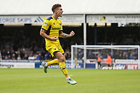Josh Ruffels of Oxford United celebrates after he scores his team's first goal of the game to make the score 1-1 during the Sky Bet League 1 match between Peterborough and Oxford United at the ABAX Stadium, London Road, Peterborough, England on 30 September 2017. Photo by David Horn.