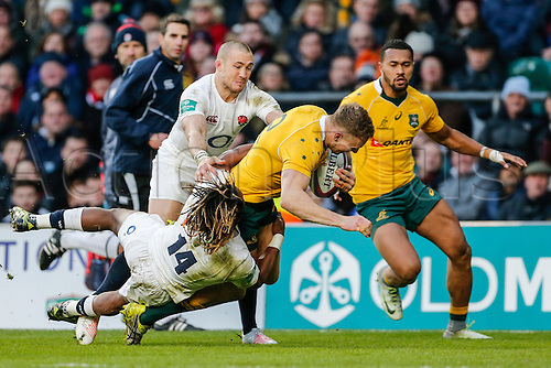 03.12.2016. Twickenham, London, England. Autumn International Rugby. England versus Australia. Reece Hodge of Australia is tackled by Marlon Yarde and Mike Brown of England.