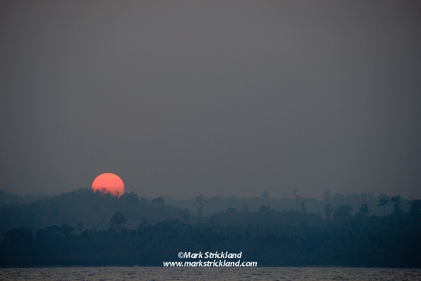 The sun sets over virgin rainforest at South Andaman, Andaman Islands, India