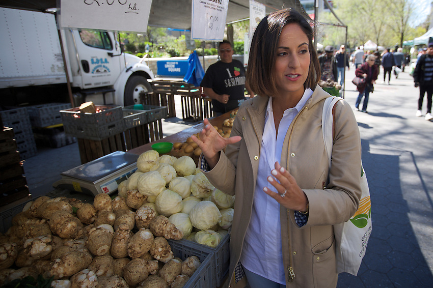 NEW YORK, NY - April 20, 2016: Cookbook author, Ali Maffucci shops for groceries at the Union Square Greenmarket.<br /> <br /> CREDIT: Clay Williams for Tastebook.<br /> <br /> &copy; Clay Williams / claywilliamsphoto.com
