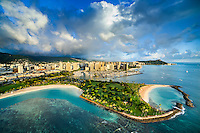 An aerial perspective of Magic Island, with Ala Wai Yacht Harbor, Waikiki and Diamond Head in the distance, Honolulu, O'ahu.