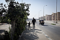 EGYPT, 6 of october city: Abu Ali and his son are going to buy some vegetables at a syrian shop nearby their home on the 13th february 2014. <br /> <br /> EGYPTE, Le Caire: Abu ali et son fils Mohammed vont acheter des l&eacute;gumes dans un magasin syrien pr&egrave;s de chez eux.  13 f&eacute;vrier 2014.