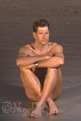 20 FEB 1999 - THE STRAND, CAPE TOWN, SOUTH AFRICA - British triathlete Simon Lessing. (PHOTO (C) NIGEL FARROW)