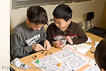 Elementary School New York Grade 3 math game two students working together horizontal two boys