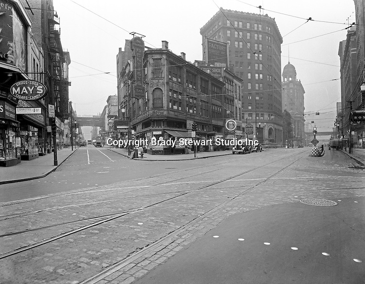 Pittsburgh PA:  View down Liberty Avenue (right) and Market Street (left) - 1935.  Nearby stores include drug store chain May's, Brass Rail, Weinberger's Discount Drug Store, Dr. Deroy Dentist