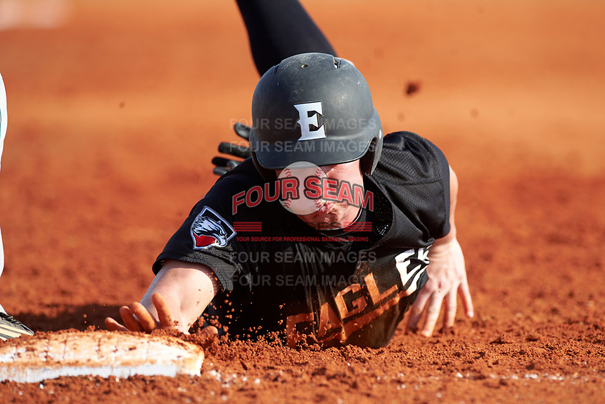 Edgewood Eagles Garrett Bogucki (25) dives back into first base during the first game of a doubleheader against the Plymouth State Panthers on April 17, 2016 at Lee County Player Development Complex in Fort Myers, Florida.  Plymouth State defeated Edgewood 6-5.  (Mike Janes/Four Seam Images)