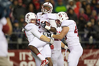 SEATTLE, WA - Stanford safety Jordan Richards, center celebrates returning an interception for a touchdown with teammates Trent Murphy, left, and Blake Lueders  September 28, 2013: Stanford against Washington State at CenturyLink Field. Stanford won 55-17