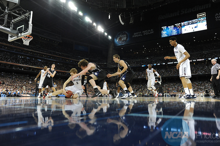 2011 APR 04:  Connecticut's Niels Giffey (5) battles for control of a loose ball against Matt Howard (54) from Butler during the 2011 NCAA Division I Men's Final Four Championship game held in Reliant Stadium in Houston, TX. UConn went on to defeat Butler 53-41 to claim the championship title.  Rich Clarkson/NCAA Photos