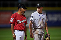 Billings Mustangs third base coach Hernan Iribarren (35) talks to Christian Koss (36) during a Pioneer League game against the Grand Junction Rockies at Dehler Park on August 15, 2019 in Billings, Montana. Billings defeated Grand Junction 11-2. (Zachary Lucy/Four Seam Images)