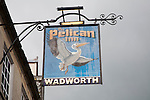 Pub sign for Wadworth beer at the Pelican Inn, Devizes, Wiltshire, England