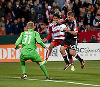 Perry Kitchen (23) of D.C. United heads the ball back to goalkeeper Joe Willis (31) as Carlos Rodriguez (22) of FC Dallas closes in at RFK Stadium in Washington DC.   Dallas FC fell to D.C. United, 4-1.