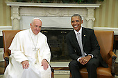 U.S. President Barack Obama (R) meets with Pope Francis (L) in the Oval Office at the White House on September 23, 2015 in Washington, DC. The Pope begins his first trip to the United States at the White House followed by a visit to St. Matthew's Cathedral, and will then hold a Mass on the grounds of the Basilica of the National Shrine of the Immaculate Conception. <br /> Credit: Alex Wong / Pool via CNP