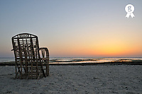 Empty wooden chair with sunrise over sea, Red Sea, Egypt (Licence this image exclusively with Getty: http://www.gettyimages.com/detail/81865730 )