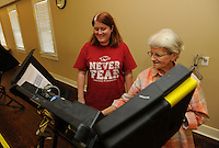 NWA Democrat-Gazette/ANDY SHUPE<br /> Mary Jane Bryles (left) receives help Tuesday, Sept. 15, 2015, from Lenora Bowlin, an election official for Washington County, before voting in the school board election at the Baldwin Church of Christ in Fayetteville.