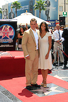 Luciana, the wife of actor Matt Damon poses for photos with him as he is honored with the 2,343rd star on the 'Hollywood Walk of Fame' on Hollywood Boulevard in Los Angeles, California on 25 July 2007. Photo by Nina Prommer/Milestone Photo
