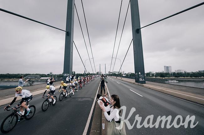 Team SKY escorting team leader Chris Froome (GBR/SKY) & yellow jersey / GC leader Geraint Thomas (GBR/SKY) over the bridge<br /> <br /> 104th Tour de France 2017<br /> Stage 2 - Düsseldorf › Liège (203.5km)
