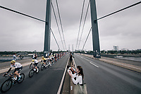 Team SKY escorting team leader Chris Froome (GBR/SKY) &amp; yellow jersey / GC leader Geraint Thomas (GBR/SKY) over the bridge<br /> <br /> 104th Tour de France 2017<br /> Stage 2 - D&uuml;sseldorf &rsaquo; Li&egrave;ge (203.5km)