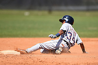 Detroit Tigers infielder Harold Castro (34) slides into second during a minor league spring training game against the Houston Astros on March 21, 2014 at Osceola County Complex in Kissimmee, Florida.  (Mike Janes/Four Seam Images)